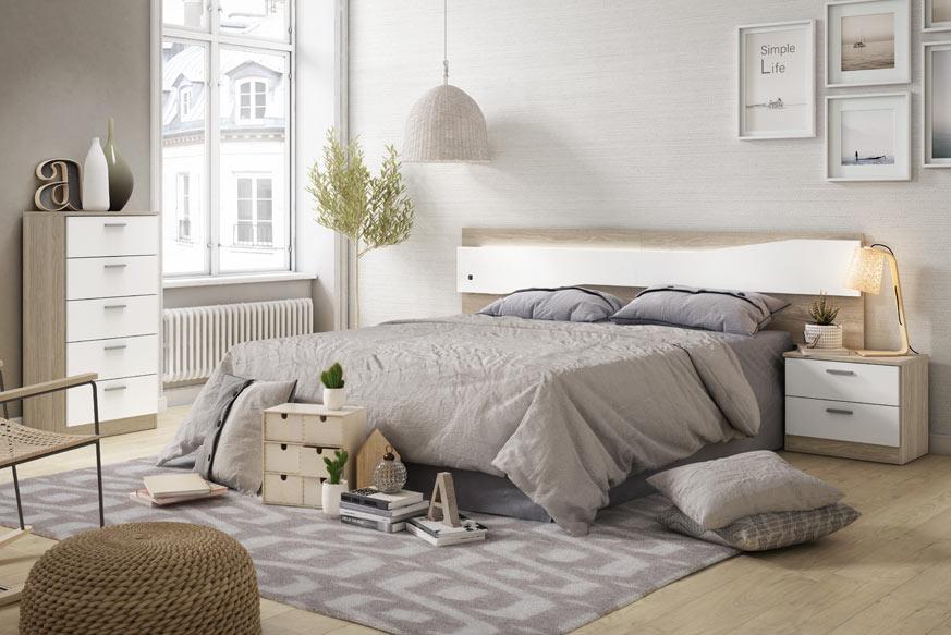 Pack de dormitorio compuesto por una cama con un cabecero y dos mesitas en la parte izquierda y un sifonier de cinco cajones en la parte derecha. Todo esto acabado en color roble y blanco.
