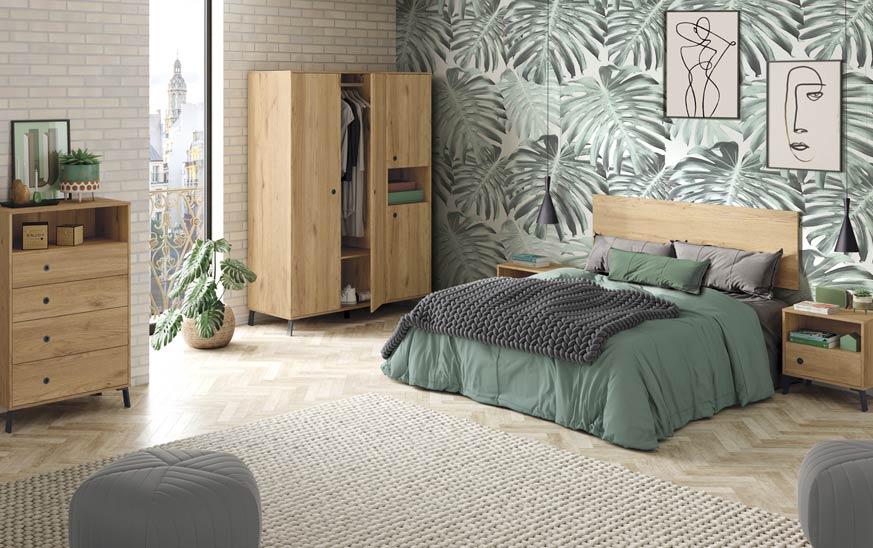 dormitorio formado por una cama y una mesita en la parte derecha. En el fondo y en centro un armario con cinco puertas. En la parte izquierda una cómoda con cuatro cajones y un hueco en la parte superior. Acabo en color roble gold y las patas negras.