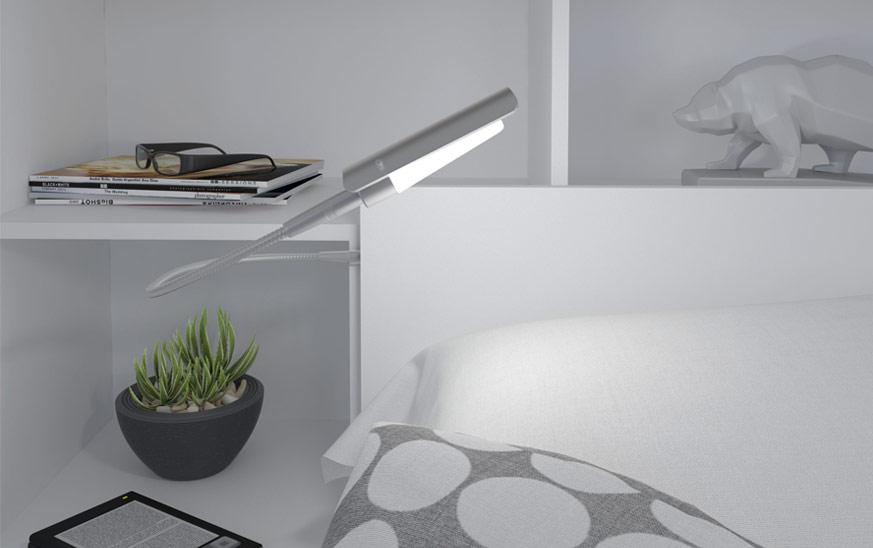 Imagen de detalle de idea de cabecero de cama con estantes y luz integrada.